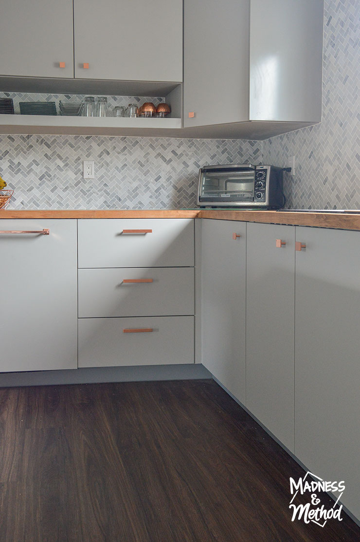gray cabinets copper handles